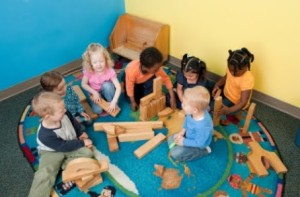 The idea of a buddy or a small group, where each child has a role in the task can be an effective way to engage them.  Photo taken  from childcarectblog.com